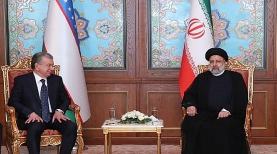 الرئيس الايراني يلتقي نظيره الاوزبكي في دوشنبة